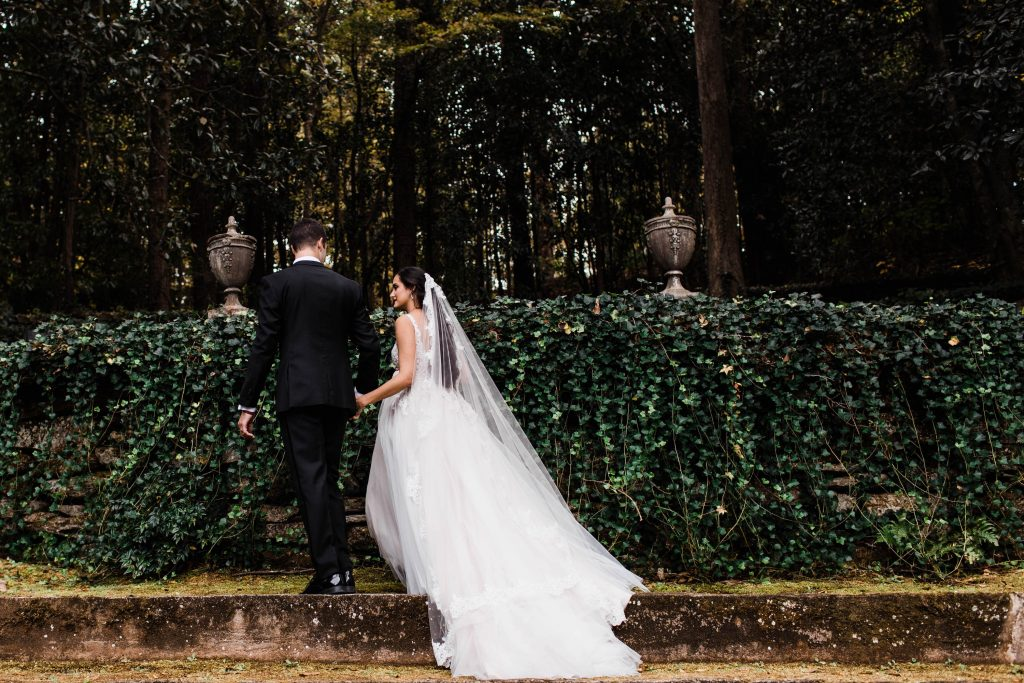 couple getting married in the woods in an ivy covered garden