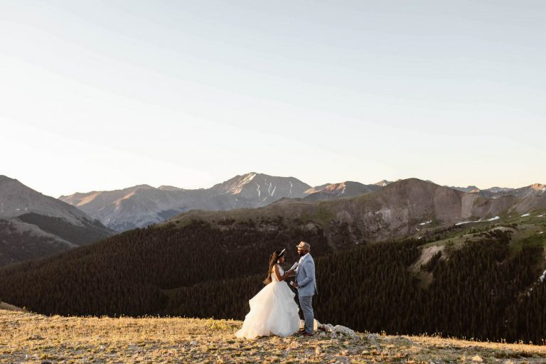 photo of couple getting married on a mountaintop documented by Colorado elopement photographers