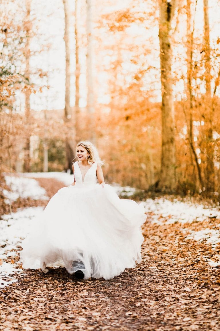 bride running down a hiking trail in her wedding dress on her Colorado adventure elopement day