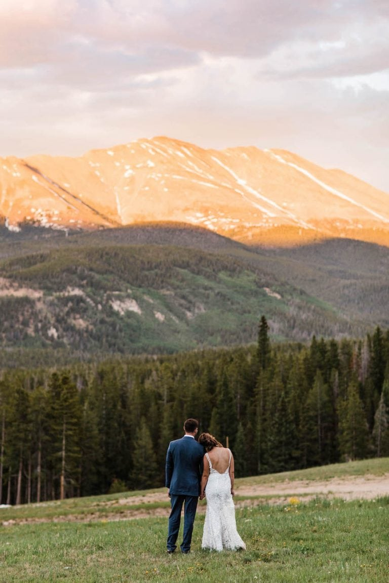 Breckenridge Colorado adventure elopement couple standing together and watching the alpenglow during their Colorado elopement day