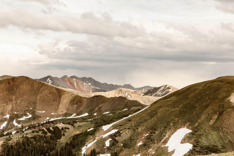 rainbow colored mountains right off a mountain pass in Colorado that would make for the perfect adventure elopement photography backdrop