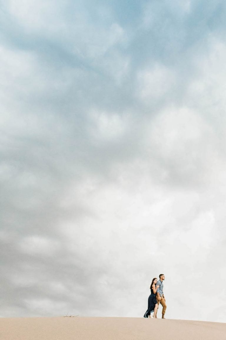 adventure elopement couple standing on a sand dune together in Colorado