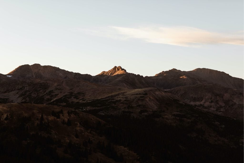 tip of a mountain in Colorado with alpenglow on it on Lindsey and Jims micro wedding day