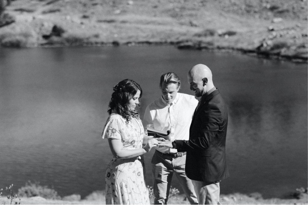 exchanging of the rings during a Colorado micro wedding ceremony