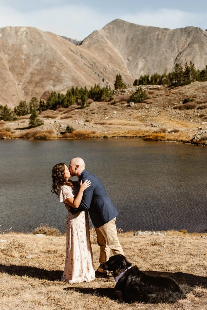 couple sharing their first kiss during their Colorado micro wedding