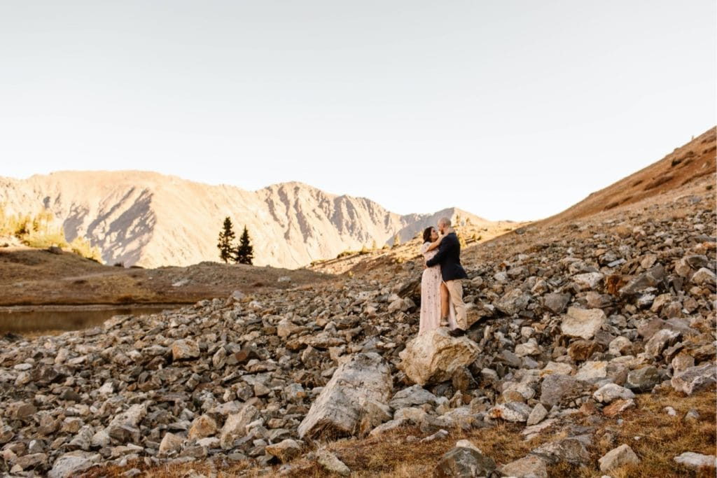 Colorado micro wedding couple kissing while standing on a rock