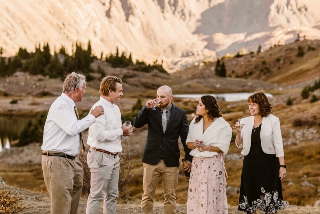celebratory champagne toast being shared amongst guests at the Colorado micro wedding