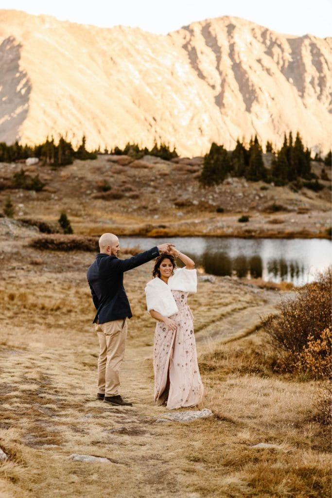 Colorado micro wedding couple dancing on the hiking trail at sunset