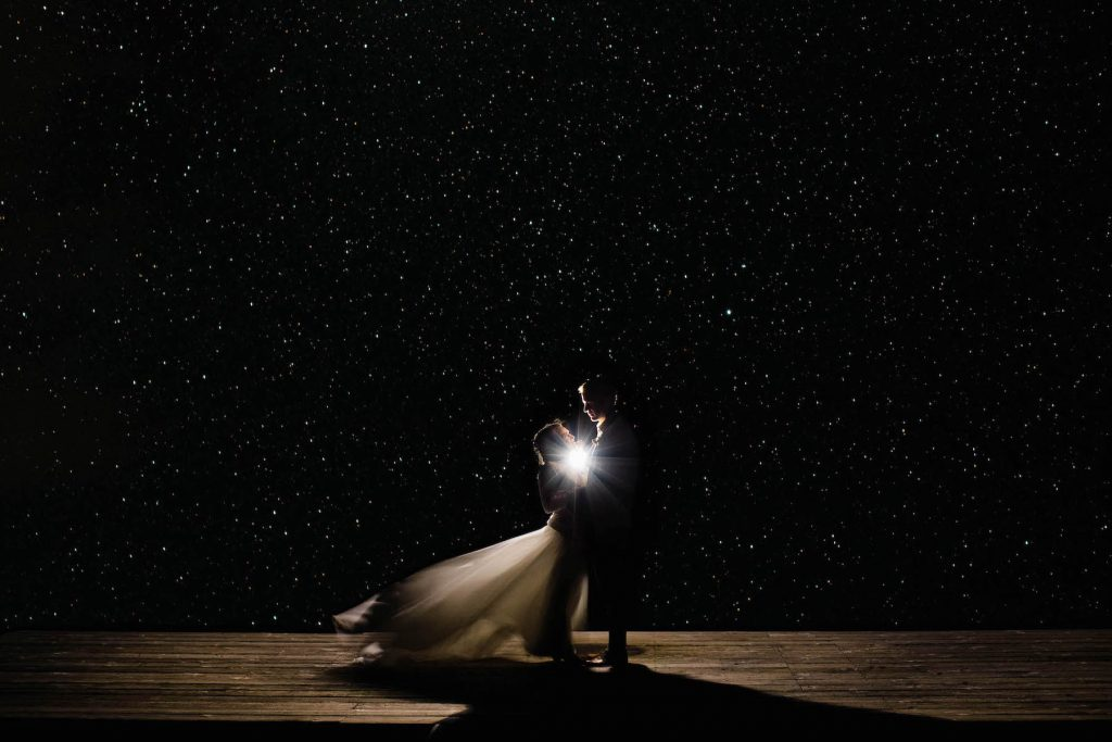 adventure wedding couple standing underneath a starry night sky in Telluride | documented by Colorado elopement photographers