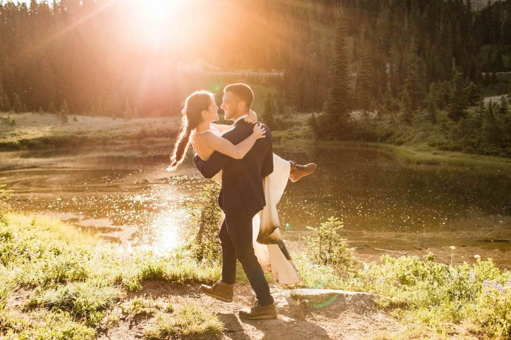 groom holding bride and spinning her around during their adventure elopement | taken by Colorado elopement photographers