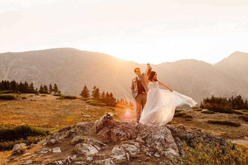 sunrise adventure wedding dancing photo taken by Colorado elopement photographers