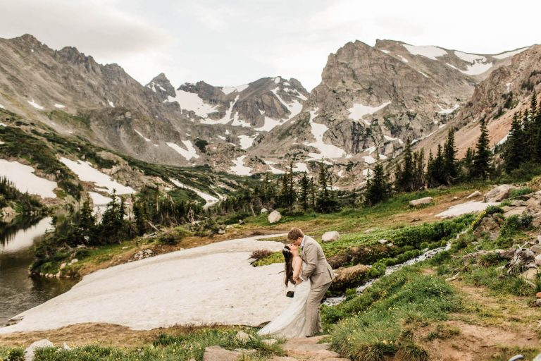 adventure elopement couple sharing a kiss in the Rocky Mountains of Colorado as their Colorado elopement photographers take photos