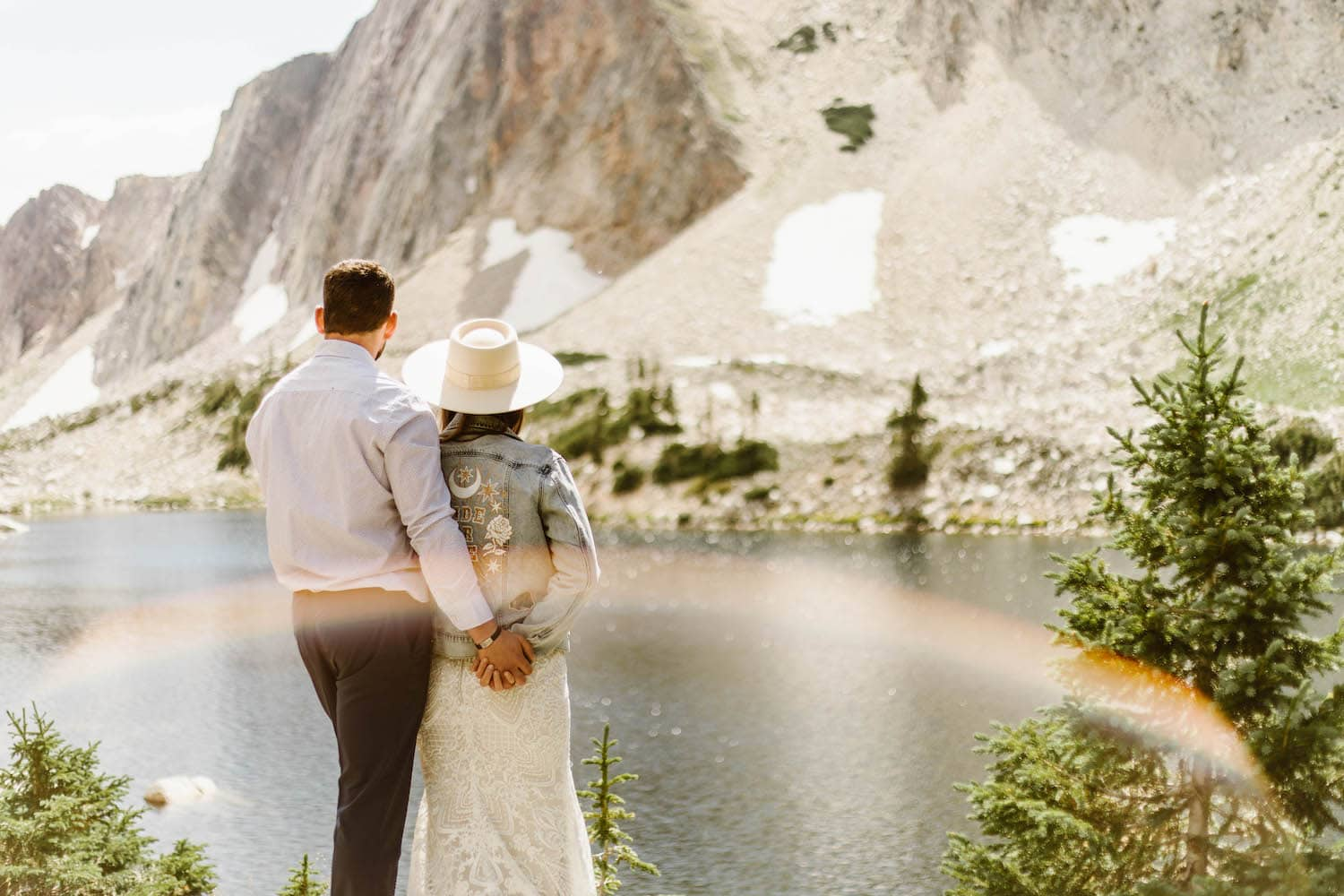 couple standing by the lake where they had their commitment ceremony