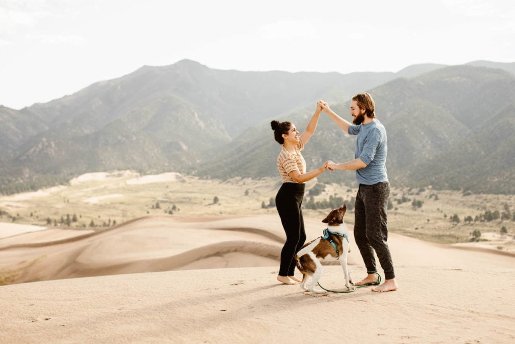 photo of Sheena Shahangian with her husband Ed and their dog Zari at the sand dunes