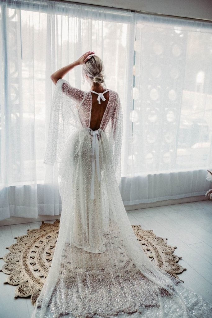 beaded sequin goddess-styled white gown with open back