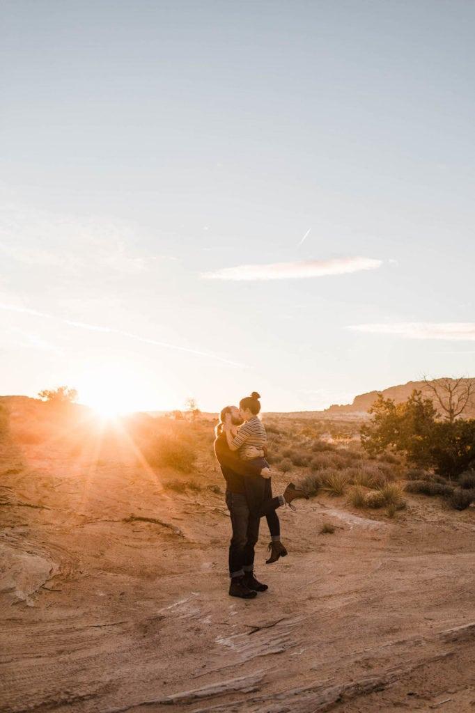couple exploring a random dirt road in Moab Utah at sunset