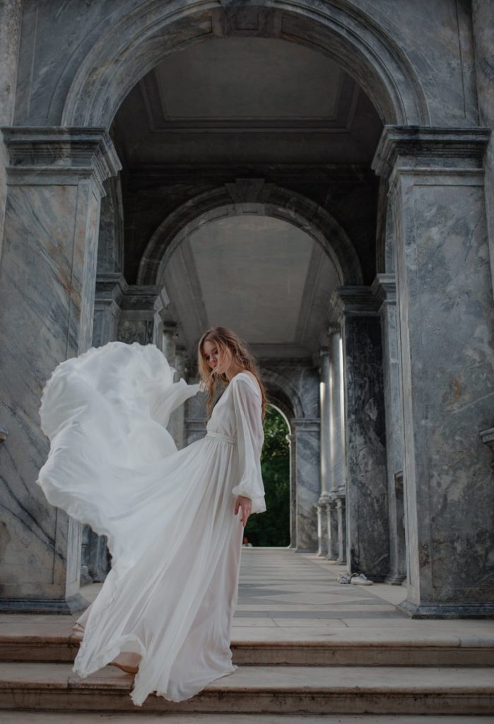 chiffon and satin flowy long sleeved greek goddess-style white gown
