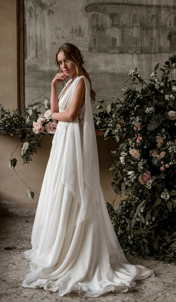 grecian goddess wedding dress with shoulder train wings silk chiffon skirt and illusion tulle