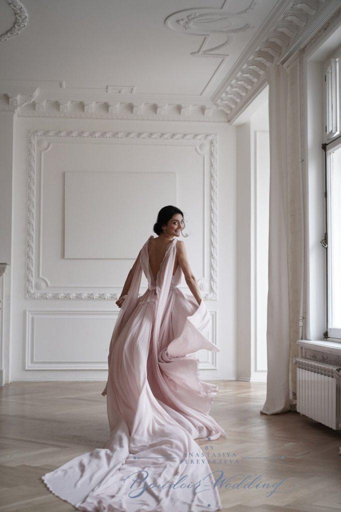 light pink goddess wedding dress with should train