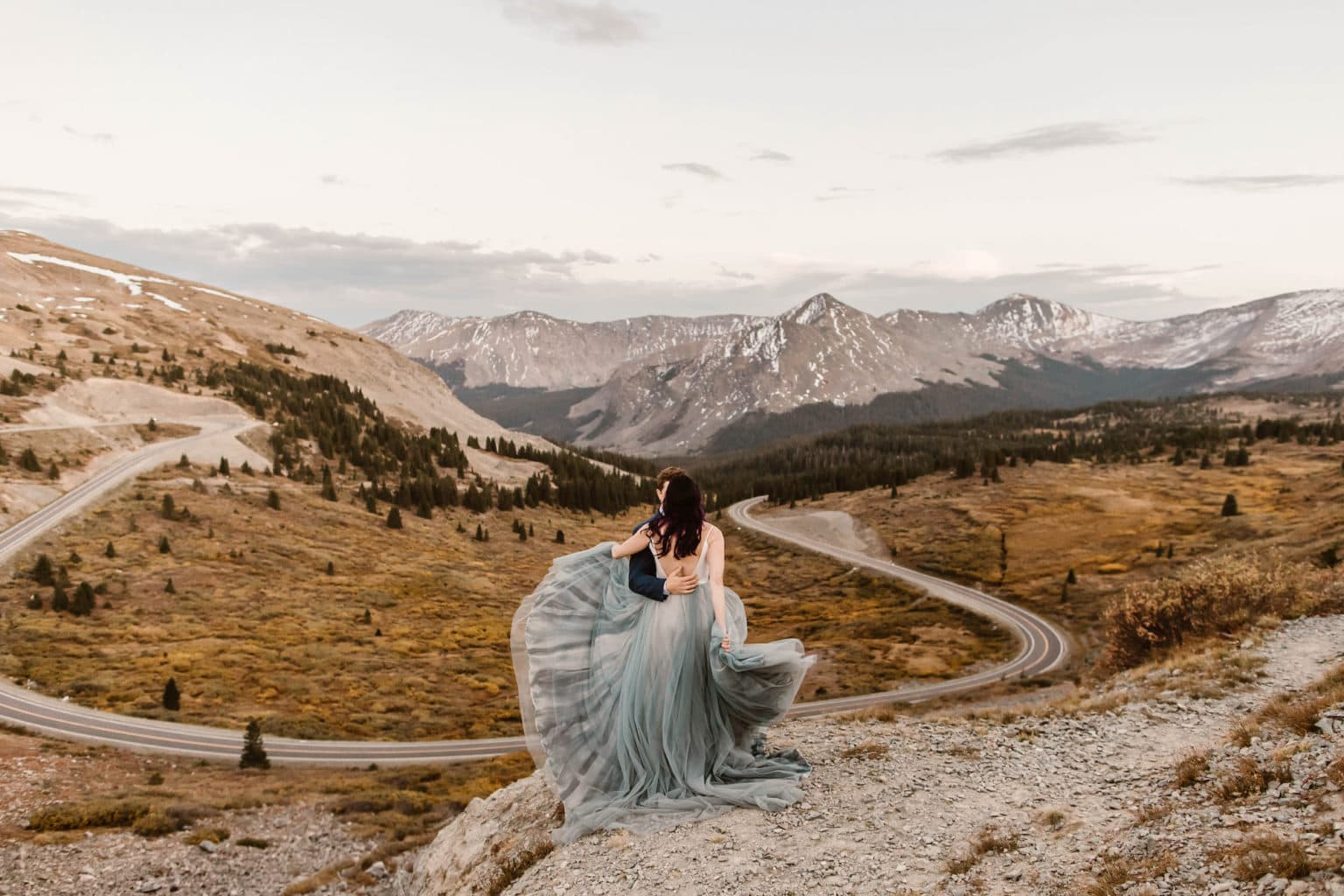 two toned goddess wedding dress hand painted blue for an elopement in the mountains