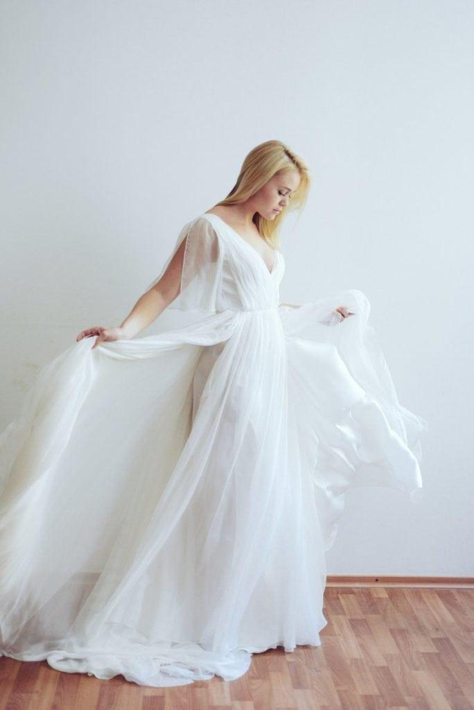 white silk and lace greek goddess wedding dress