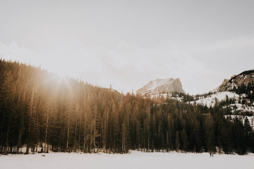snow covered Bear Lake in Rocky Mountain National Park at sunset