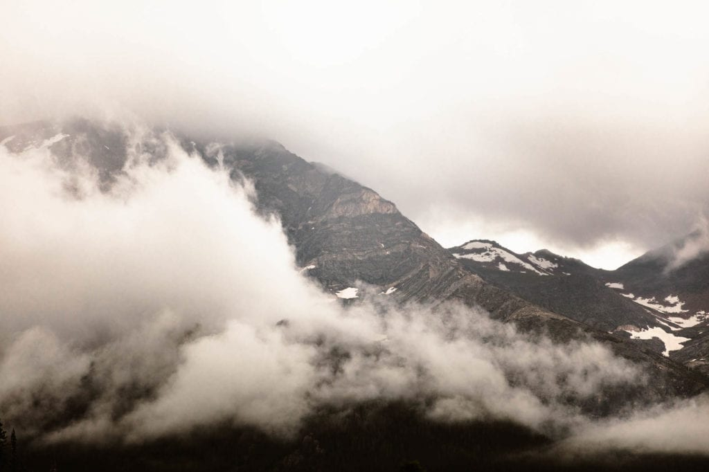 view of mountains shrouded in clouds at Many Parks Curve Overlook on Trail Ridge Road in Rocky Mountain National Park