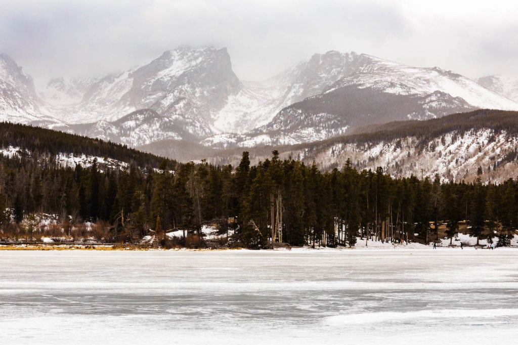Sprague Lake in Rocky Mountain National Park covered in snow and ice