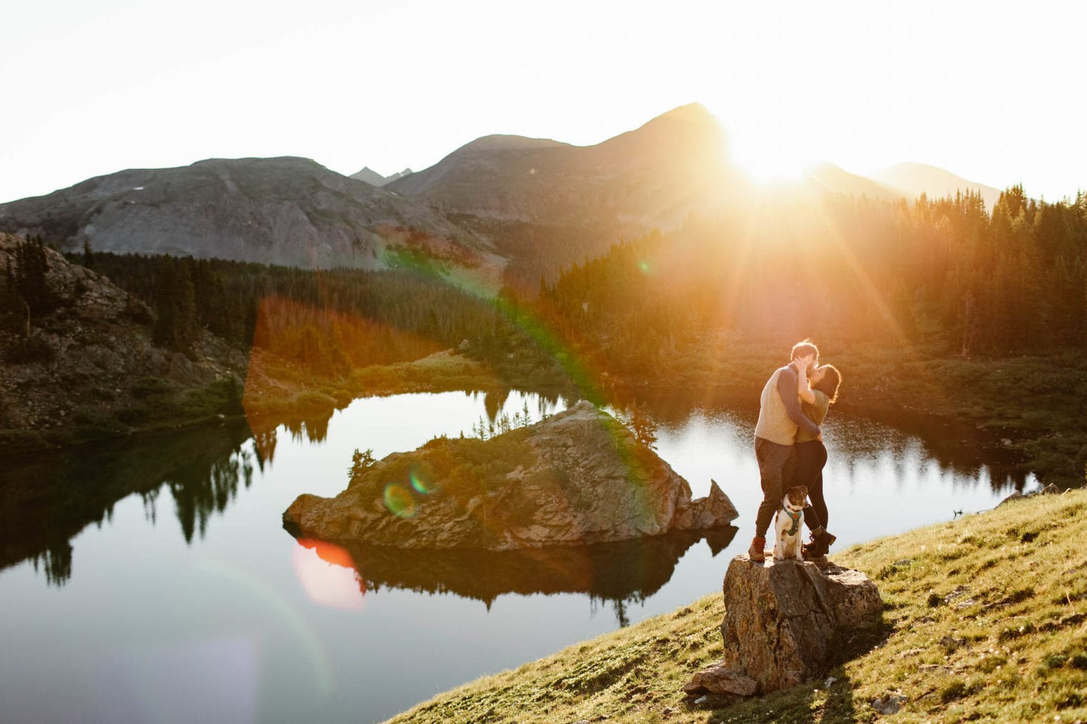 couple standing by an alpine lake in Colorado during the best time to visit the high country